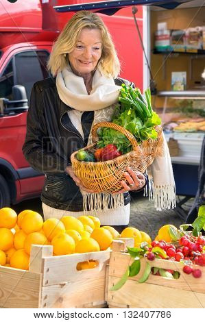 Woman At Farmers Market With Basket Of Vegetables
