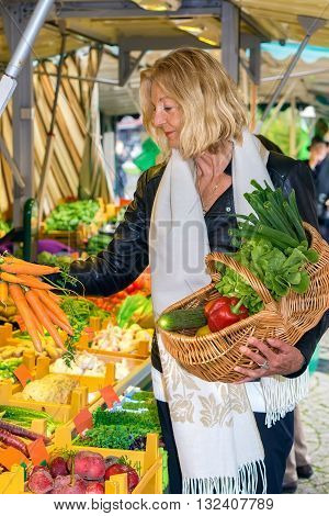 Woman Selecting A Bunch Of Fresh Carrots