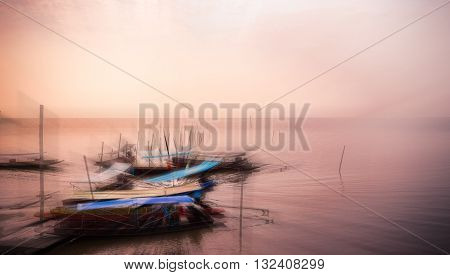 Blur  Image Of Small Boat In Seaport.