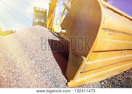 industrial excavator shovel against sunny blue sky
