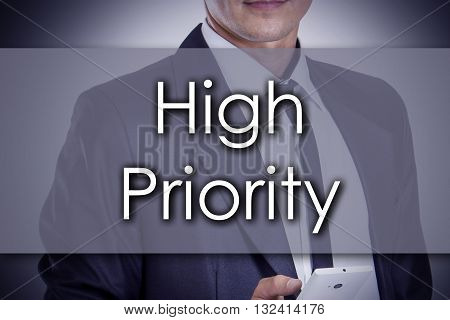 High Priority - Young Businessman With Text - Business Concept