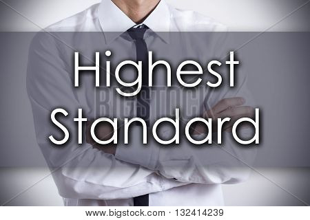 Highest Standard - Young Businessman With Text - Business Concept