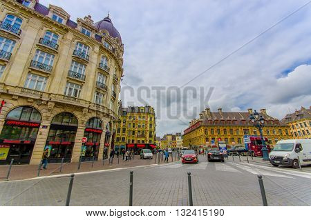 Lille, France - June 3, 2015: Side street from beautiful Place Grande with its charming buildings and traditional european architecture sorrounding the plaza on a nice summer day.