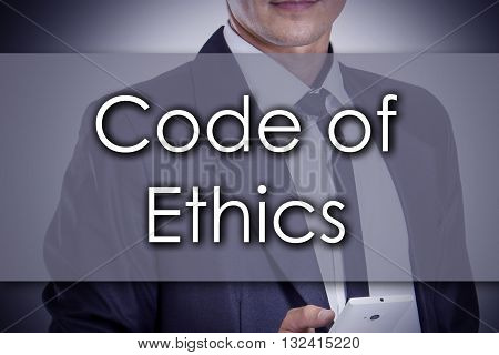 Code Of Ethics - Young Businessman With Text - Business Concept