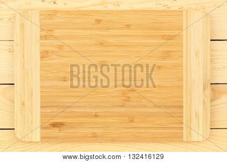 new bamboo cutting board on wooden planks