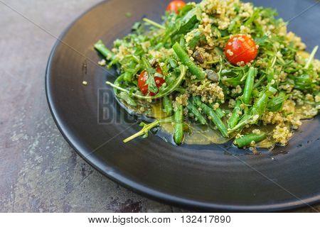 Yellow beetroot carpaccio with quinoa rucola green bean salad and pumpkin seeds