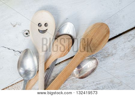 One spoon with smiley face standing with the crowd - individuality.