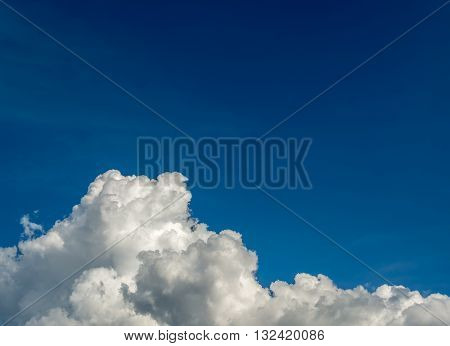 White Cumulus Clouds In The Blue Sky For