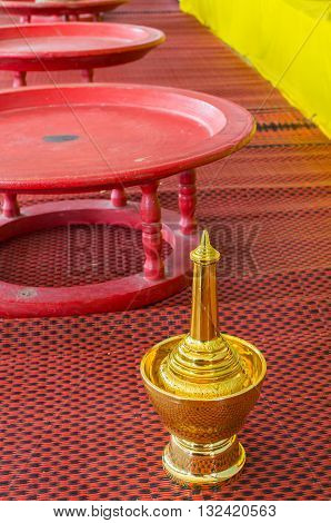 image of golden pour water containers for Buddhist temple ceremony.