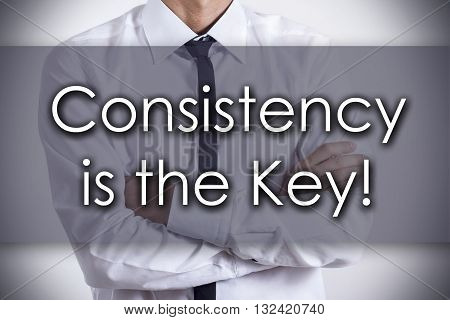 Consistency Is The Key! - Young Businessman With Text - Business Concept