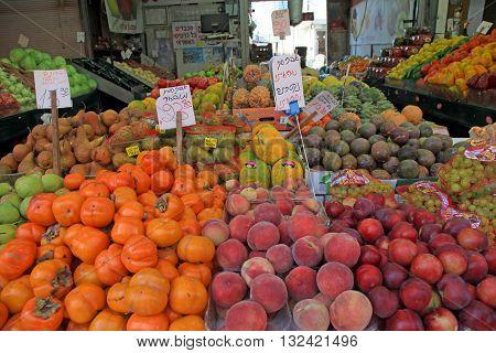 TEL AVIV, ISRAEL - APRIL 3, 2016: Fresh fruits are sold in the outdoor Carmel Market in Tel Aviv, Israel.