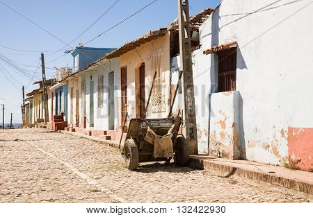 A cart in a historic colonial street with colored houses in Trinidad Cuba