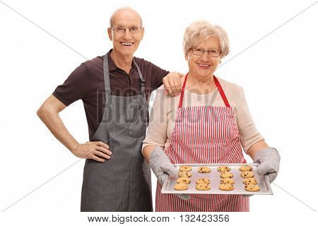 Senior couple posing with homemade chocolate chip cookies isolated on white background