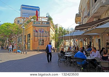 TEL AVIV, ISRAEL - APRIL 3, 2016: People at outdoor cafe at Nahalat Binyamin district, Tel Aviv, Israel. Selective focus.