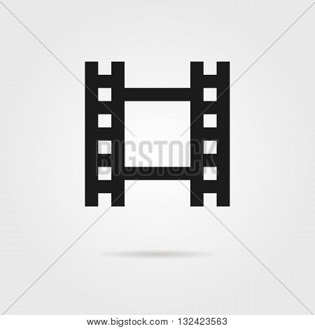 simple celluloid film black icon. concept of footage, 35 mm format, television, cinematography, film roll, slide. isolated on grey background. flat style trendy modern logo design vector illustration