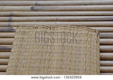 bamboo mat on litter on bamboo table