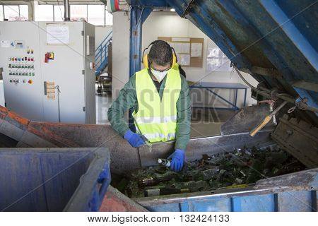 Glass Waste Worker In Recycling Facility