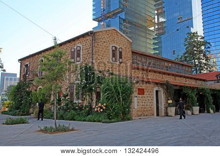 TEL AVIV, ISRAEL - APRIL 7, 2016: Old and modern buildings at dusk at the Sarona district, Tel Aviv, Israel. Recently open Sarona Market became the most popular place in Tel Aviv.