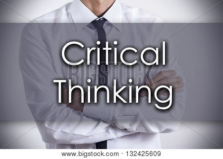 Critical Thinking - Young Businessman With Text - Business Concept