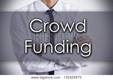 Crowd Funding - Young Businessman With Text - Business Concept