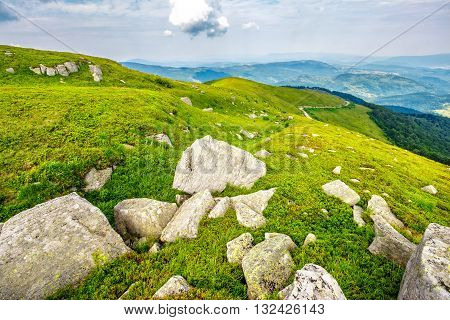 white sharp boulders on the hillside in high mountains