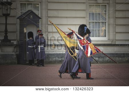 London, United Kingdom - November 5, 2012: Changing of guard ceremony in Buckingham palace at old traditional way in London, England