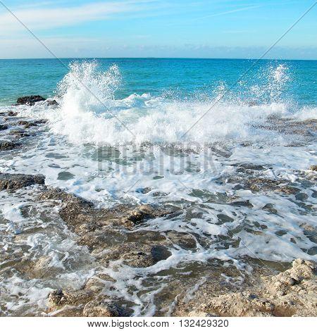 Big Wave Crashing On The Rocks
