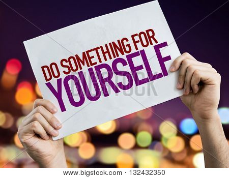Do Something for Yourself placard with night lights on background