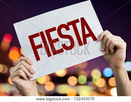 Party (in Spanish) placard with night lights on background