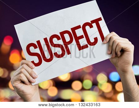 Suspect placard with night lights on background