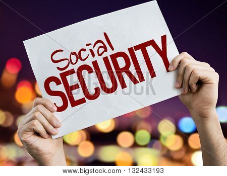 Social Security placard with night lights on background