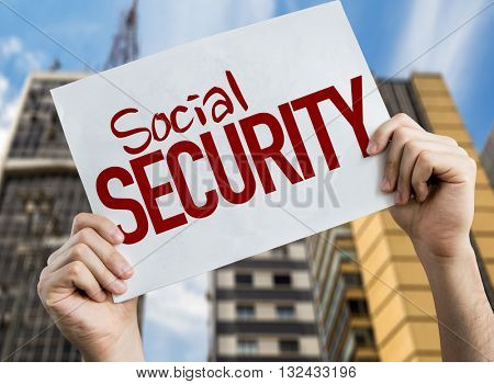 Social Security placard with urban background