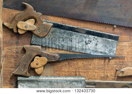 Detail of the set of various old and used hand saws