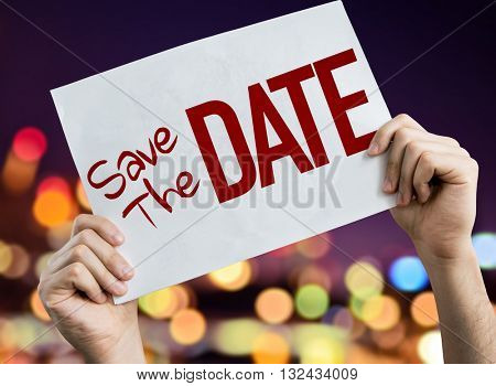 Save the Date placard with night lights on background