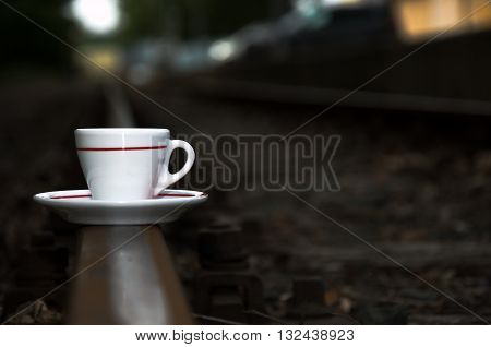 Morning coffee on the sidelines and waiting for a delayed train