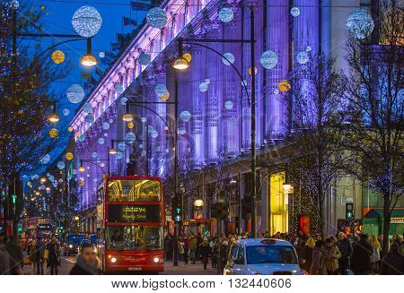 LONDON, UK - DECEMBER 30, 2015: Selfridges department store. Christmas lights decoration at Oxford street and lots of people walking during the Christmas sale