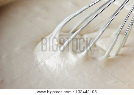 Mixing Batter or dough for banana cake or muffin or pancake. Close up, soft focus.