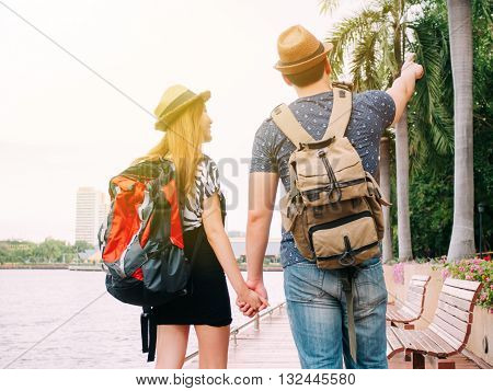 Couple Travelers Walking And Holding Hands Together - Journey Of Love And Travel