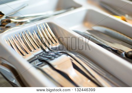 forks closeup cutlery drawer background silverware compartments kitchen utensils
