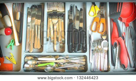 vintage cutlery drawer background silverware colorful compartments kitchen utensils