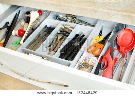 cutlery drawer background silverware colorful compartments kitchen utensils