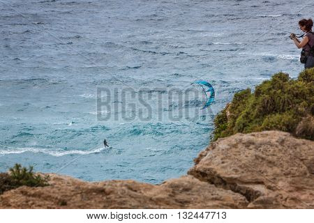 Siggiewi, Malta - May 04, 2016: The View From The Cliffs On The Kiteboarder.