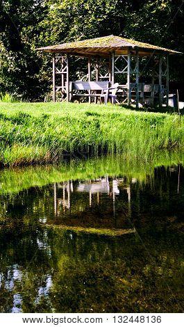 wooden gazebo in the lake. landscape nature
