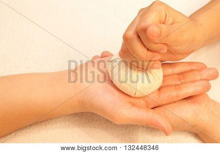 reflexology Hand massage by ball herbal spa hand treatment Thailand