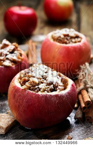Baked apples stuffed with cereal and honey close up view