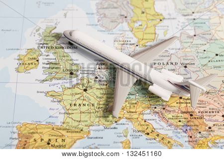 Travel Destination United Kingdom. Passenger Plane Miniature Over Map
