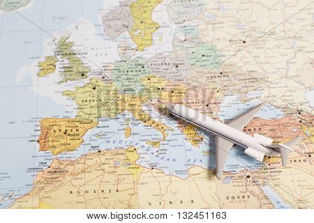 Travel Destination Europe. Passenger Plane Miniature Over The Map