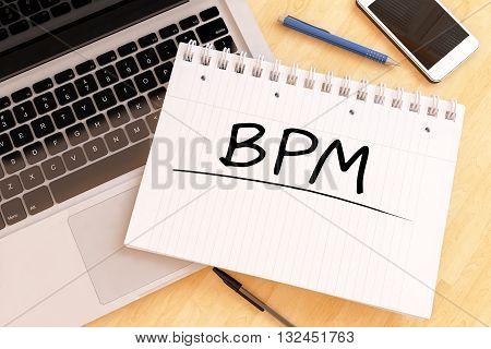 BPM - Business Process Management - handwritten text in a notebook on a desk - 3d render illustration.