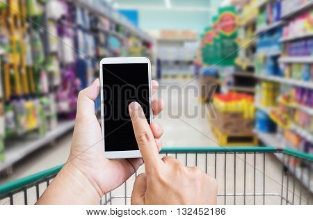 Hand Press On Big Blank Smartphone Screen Or Mobile Phone On Shopping Mall Background, Blank Cellpho
