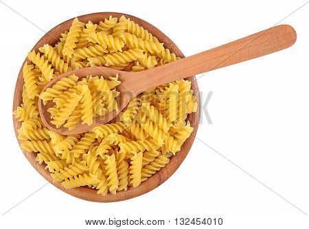 Uncooked Italian Pasta Fusilli In A Wooden Bowl On A White